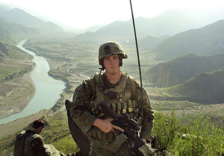 Dakota Meyer, seen here while deployed in Ganjgal Village, Afghanistan, is the 296th Marine to receive the award. Photo: ASSOCIATED PRESS