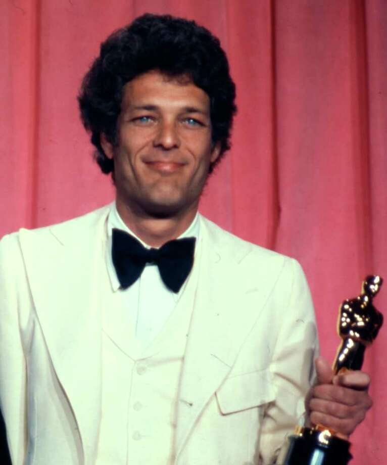 """FILE - In an April 8, 1975 file photo, movie producer Bert Schneider holds the Oscar he received with co-producer Peter Davis for Best Documentary feature, """"Hearts and Minds,"""" at the 47th annual Academy Awards at the L.A. Music Center.  """"Five Easy Pieces"""" producer Bert Schneider, credited for inspiring a """"New Hollywood"""" band of independent filmmakers, died Monday, Dec. 12, 2011 in Los Angeles, his daughter Audrey Simon tells the Los Angeles Times. He was 78. (AP Photo/File)"""