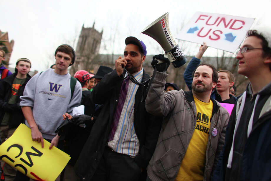 Garfield High history teacher Jesse Hagopian speaks as hundreds of students march on the campus of the University of Washington during a walkout by Seattle area high school students. Photo: JOSHUA TRUJILLO / SEATTLEPI.COM