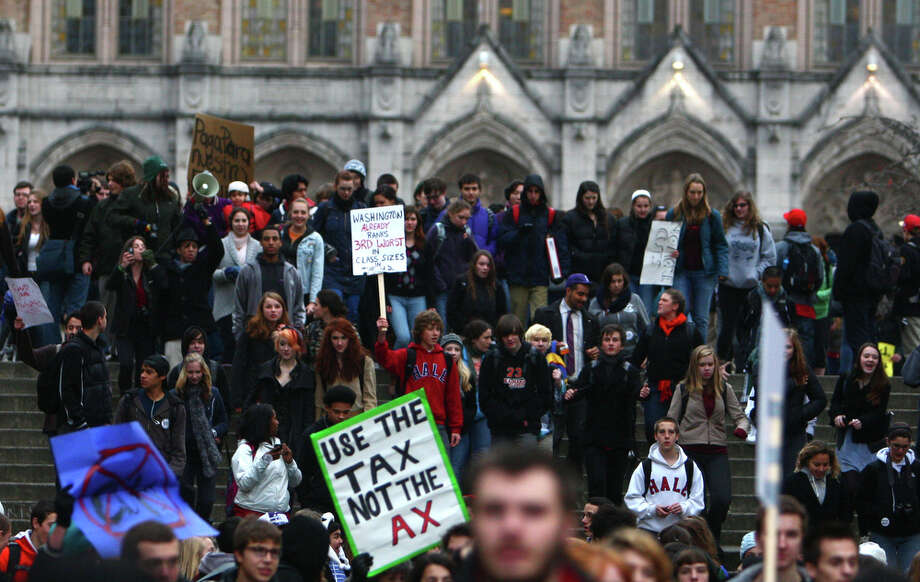 Hundreds of high school students march on the campus of the University 