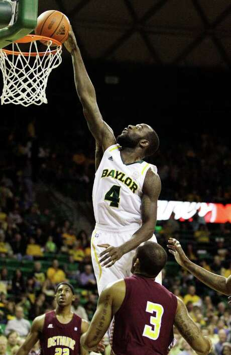 Baylor's Quincy Acy gets a dunks while Bethune-Cookman's Paul Scotland (3) and Ricky Johnson can only watch. Photo: AP