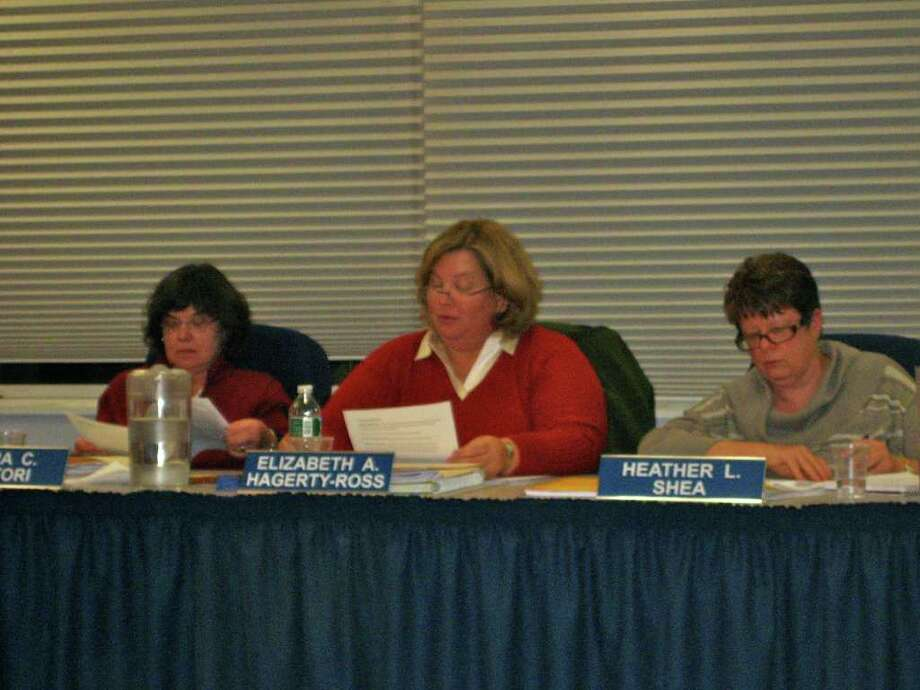 Board of Education members Clara Sartori, Elizabeth Hagerty-Ross and Heather Shea review the world language proposal at Tuesday night's meeting. Photo by Thomas Michael Photo: Contributed Photo
