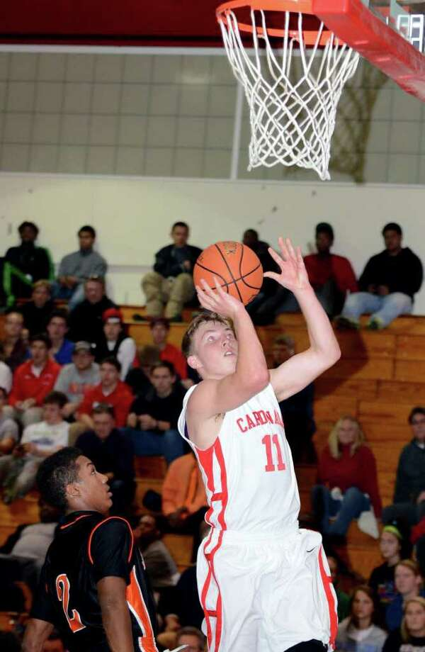 Greenwich's Alex McMurray (11) goes up for a shot during the boys basketball game against Stamford at Greenwich High School on Wednesday, Dec. 14, 2011. Photo: Amy Mortensen / Connecticut Post Freelance