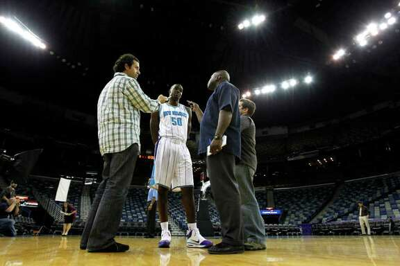 New Orleans Hornets center Emeka Okafor (50) talks to reporters during the New Orleans Hornets NBA basketball media day at the New Orleans Arena in New Orleans, Wednesday, Dec. 14, 2011. (AP Photo/Gerald Herbert)