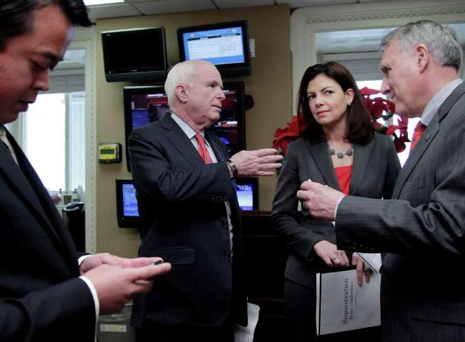 From right, Senate Minority Whip Jon Kyl of Ariz., Sen. Kelly Ayotte, R-N.H., and Sen. John McCain, R-Ariz.,  ranking Republican on the Senate Armed Services Committee, confer before a news conference on Capitol Hill in Washington, Wednesday, Dec. 14, 2011, to announce an effort to replace the defense sequester mandated as a result of the Supercommittee's failure.  (AP Photo/J. Scott Applewhite) Photo: J. Scott Applewhite