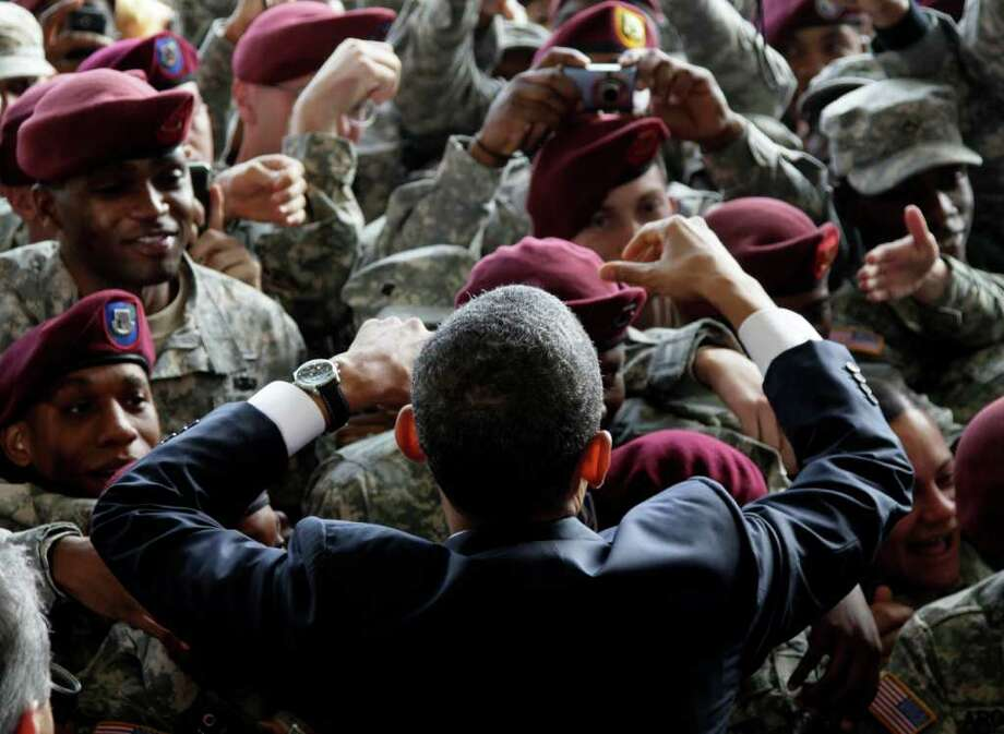 President Barack Obama greets members of the military at Fort Bragg, N.C., Wednesday, Dec. 14, 2011. (AP Photo/Carolyn Kaster) Photo: Carolyn Kaster