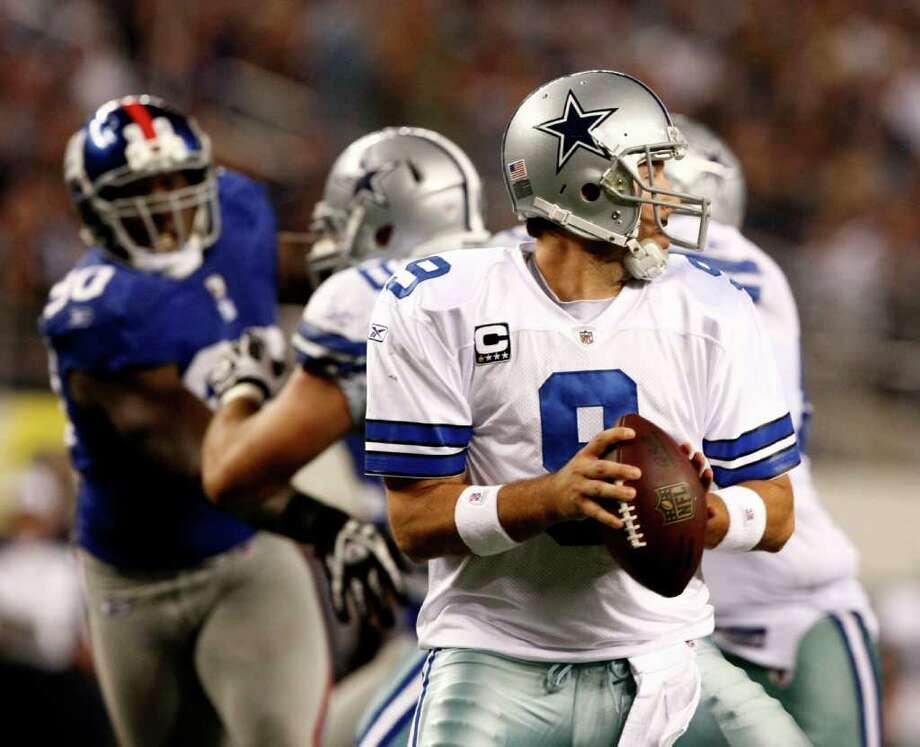 Dallas Cowboys quarterback Tony Romo (9) pressured by New York Giants defensive end Jason Pierre-Paul (90) during the Second half of an NFL football game Sunday, Dec.11, 2011, in Arlington, Texas. (AP Photo/Waco Tribune Herald/ Jose Yau) Photo: Jose Yau