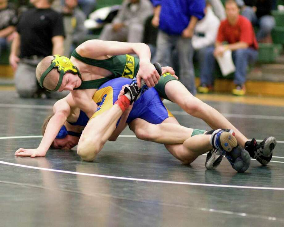 Photo by Barry Horn New Milford's Conor Kirkegard, top, won the 103-pound SWC wrestling championship with a decision over Jack McKeever of Brookfield Saturday at New Milford High. Photo: ST