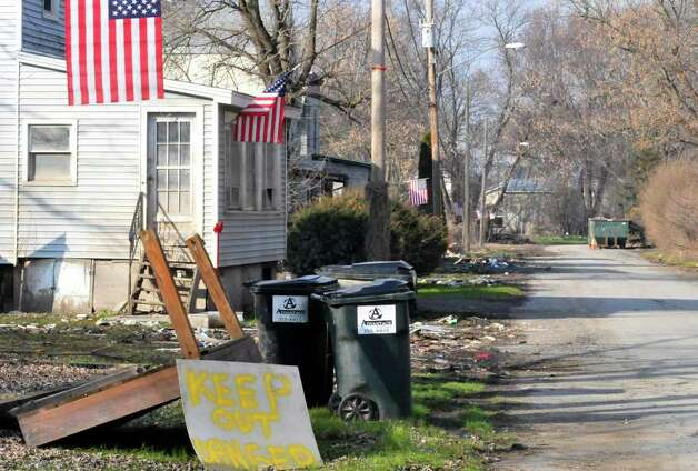 Homes still under recovery on Isabella Street in Rotterdam Junction, NY, on Wednesday, Dec.14, 2011. The two-story homes had to be gutted after suffering damage from tropical storms Irene and Lee. ( Michael P. Farrell/Times Union) Photo: Michael P. Farrell