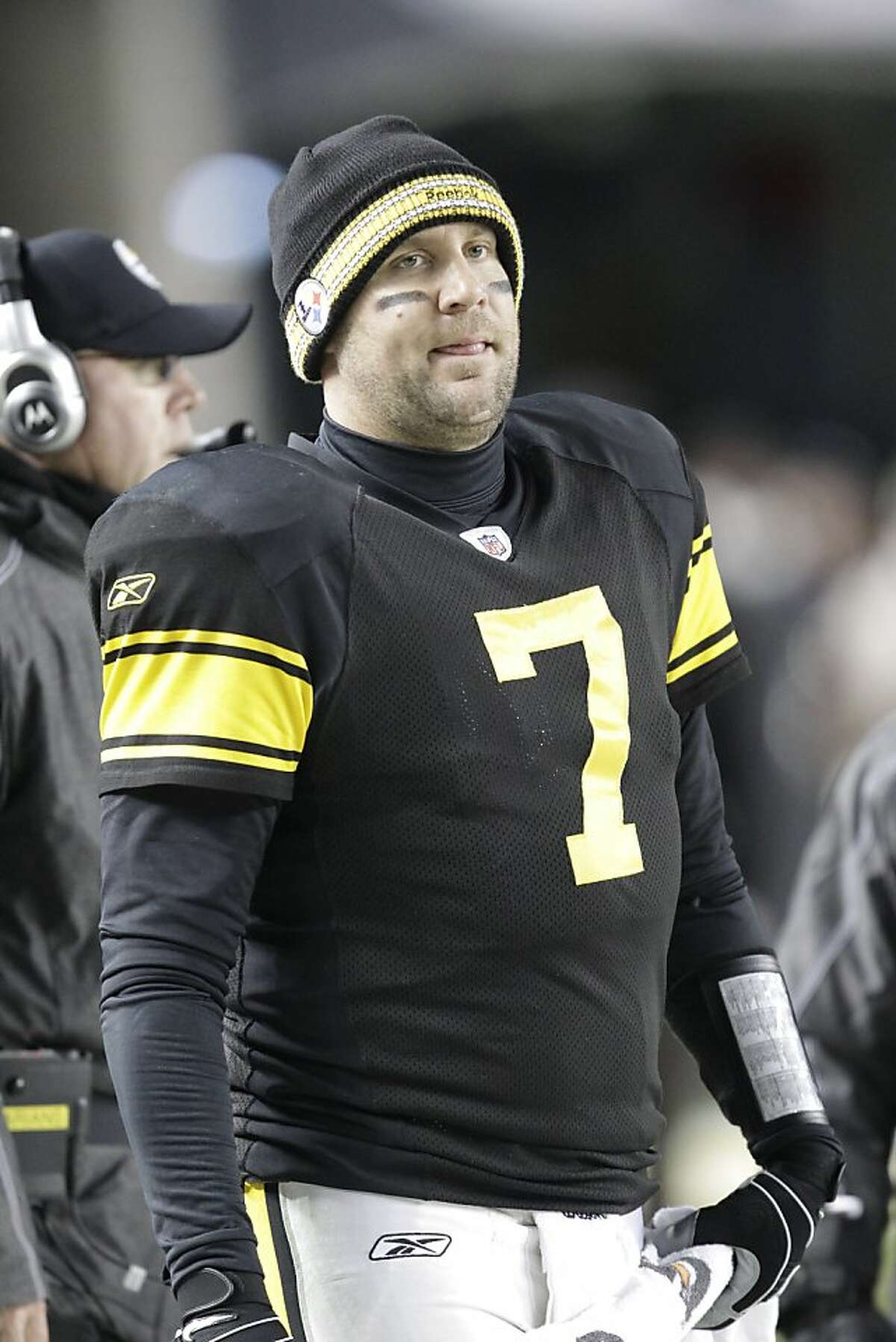 Pittsburgh Steelers quarterback Ben Roethlisberger (7) stands on the sidelines during the fourth quarter of an NFL football game against the Cleveland Browns in Pittsburgh, Thursday, Dec. 8, 2011. Roethlisberger injured his left ankle in the second quarter but remained in the game. The Steelers won 14-3. (AP Photo/Gene J. Puskar)