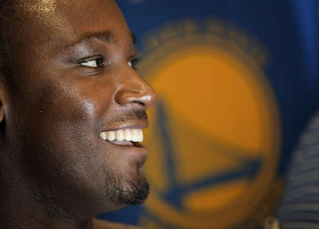Kwame Brown speaks with reporters after Golden State Warriors GM Larry Riley, announced his signing a one-year contract with the Warriors at the team's headquarters in Oakland, Calif., on Wednesday, December 14, 2011. Photo: Carlos Avila Gonzalez, The Chronicle
