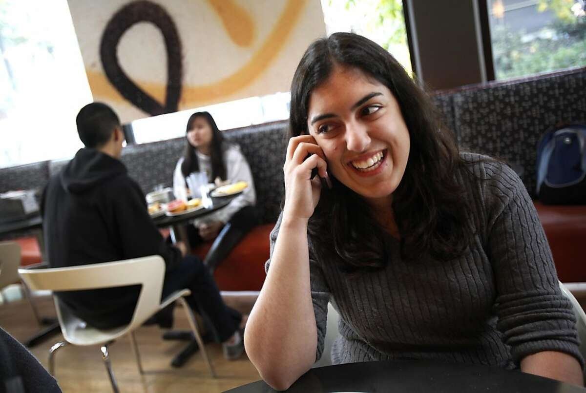 Mercedeh Sabeti, 18, a UC Berkeley freshman from San Jose, calls her dad to tell him about new tuition help for middle class families in Berkeley, Calif., Wednesday, December 14, 2011. Under the new guidelines her father will now benefit from the tuition assistance.