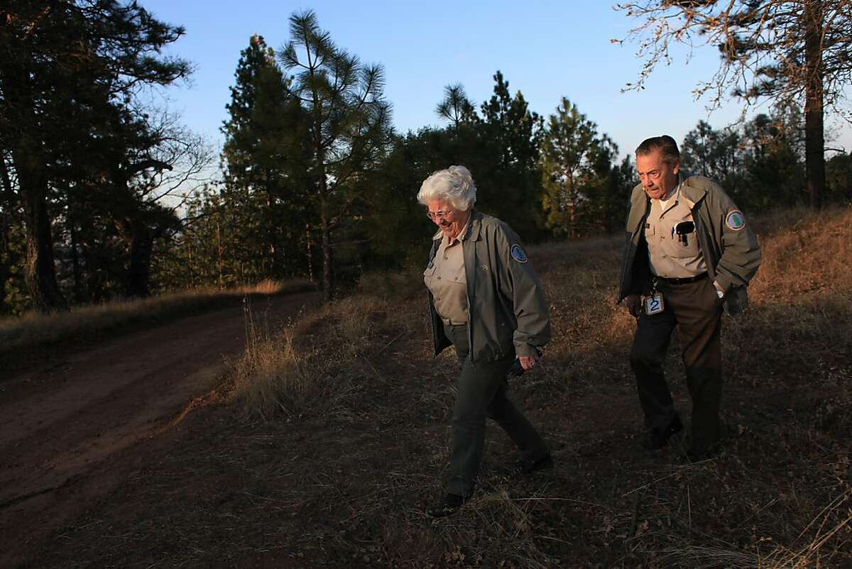 Husband and wife volunteers, Ann Briggs (r to l), President and Chair of the Coe Park Preservation Fund, and Winslow Briggs, Secretary of the Coe Park Preservation walk along Pine Ridge at Henry W. Coe State Park on Tuesday, December 13, 2011 in Morgan Hill, Calif.