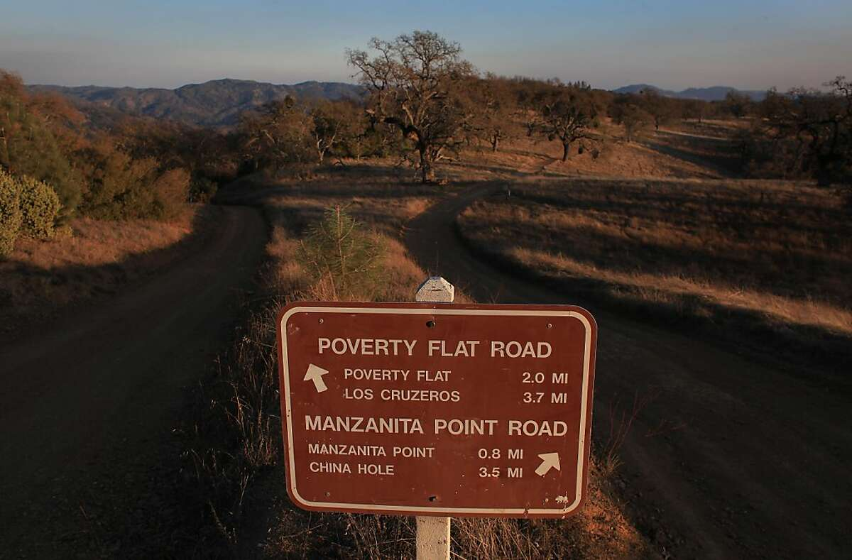 A sign guides hikers to the Poverty Flat Road and Manzanita Point Road at Henry W. Coe State Park on Tuesday, December 13, 2011 in Morgan Hill, Calif.