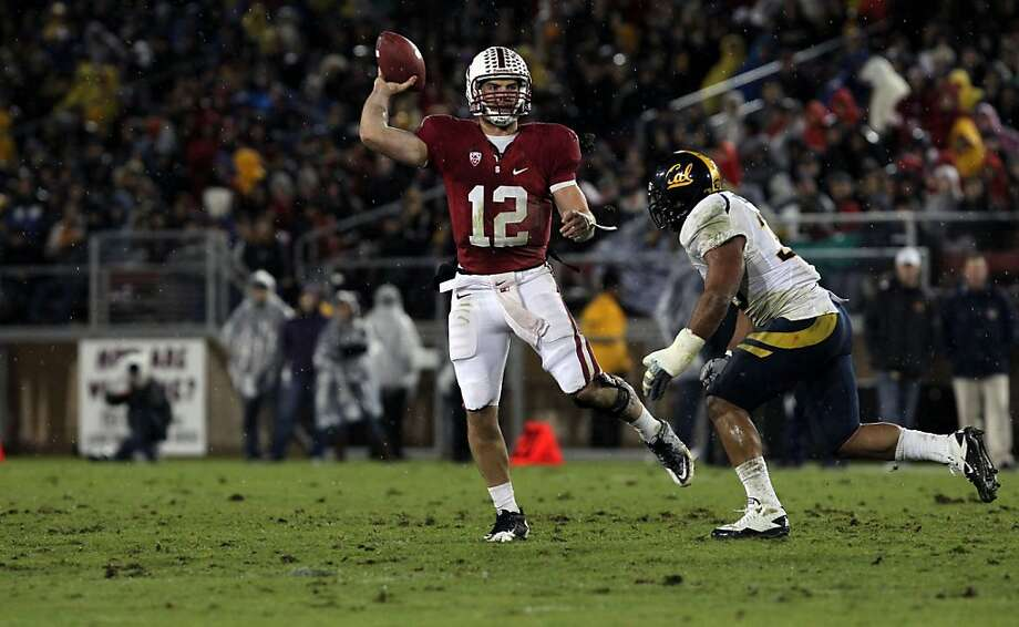 Stanford Cardinal quarterback Andrew Luck completes a second quarter pass against the California Bears at Stanford Stadium despite the rutted field on November 19, 2011 in Stanford, California. Photo: Lance Iversen, The Chronicle