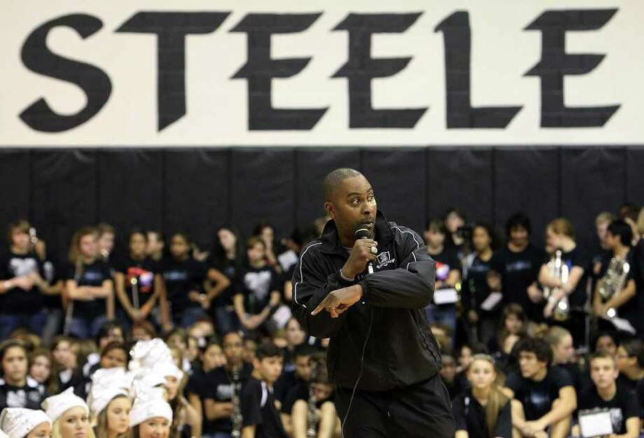 Steele football head coach Mike Jinks tries to motivate the crowd during the pep rally for the football team at Steele High School on Wednesday, Dec. 14, 2011. The Knights will be playing in the Class 5A Div. II state championship at Cowboys Stadium on Saturday. Photo: Kin Man Hui, SAN ANTONIO EXPRESS-NEWS  / San Antonio Express-News
