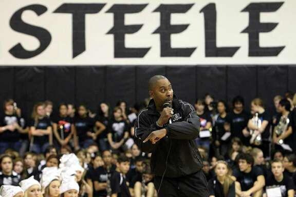 Steele football head coach Mike Jinks tries to motivate the crowd during the pep rally for the football team at Steele High School on Wednesday, Dec. 14, 2011. The Knights will be playing in the Class 5A Div. II state championship at Cowboys Stadium on Saturday.