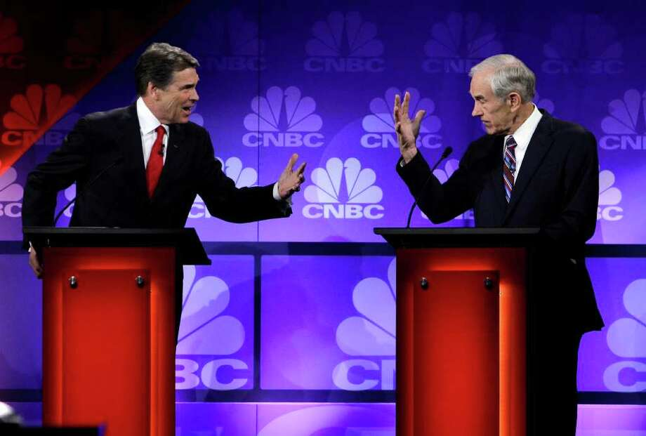 Rick Perry and Ron Paul seemed to be at odds at a November debate in Auburn Hills, Mich. But the two are both fighting to knock off Newt Gingrich and Mitt Romney. Photo: Paul Sancya, Associated Press