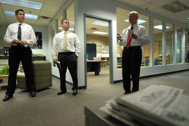 Dan Couto, director of operations for the Times Union, left, and Brad Calhoun, Times Union data integration/infrastructure manager, center, listen as George R. Hearst III, publisher of the Times Union, right, announced the paper?s purchase of a new printing press from Koenig and Bauer AG of Germany, during a newsroom gathering Monday afternoon in Colonie, N.Y. Dec. 12, 2011. The new press is scheduled to come online in the spring of 2013. (Will Waldron / Times Union) Photo: Will Waldron