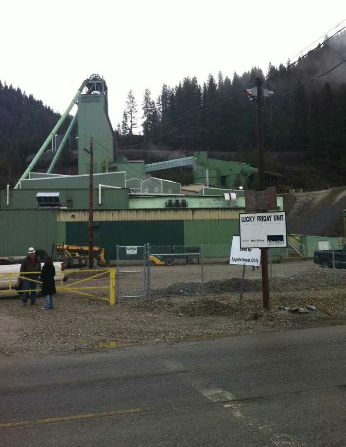 FILE - People stand at the entrance to the Lucky Friday Mine in Mullan, Idaho, in this April 16, 2011 file photo. An Idaho sheriff's officer says an underground rescue team has been sent to a mine after authorities received a report that miners have either been trapped or buried. Shoshone County sheriff's Capt. Holly Lindsey says Wednesday night Dec. 14, 2011 that it's unknown how many miners are involved or whether there are any injuries at the Lucky Friday Mine in northern Idaho.  (AP Photo/KHQ-TV) Photo: Anonymous / AP2011