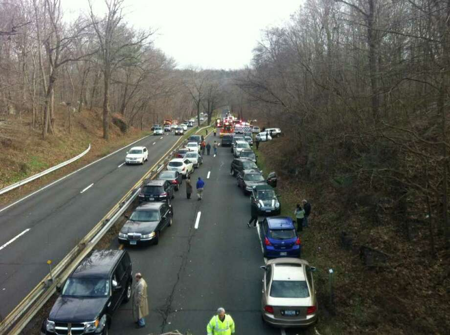 Greenwich firefighters and other emergency personnel at the scene of a serious accident near Den Road on the northbound side of the Merrit Parkway on Thursday, Dec. 15, 2011. Photo: John Nickerson