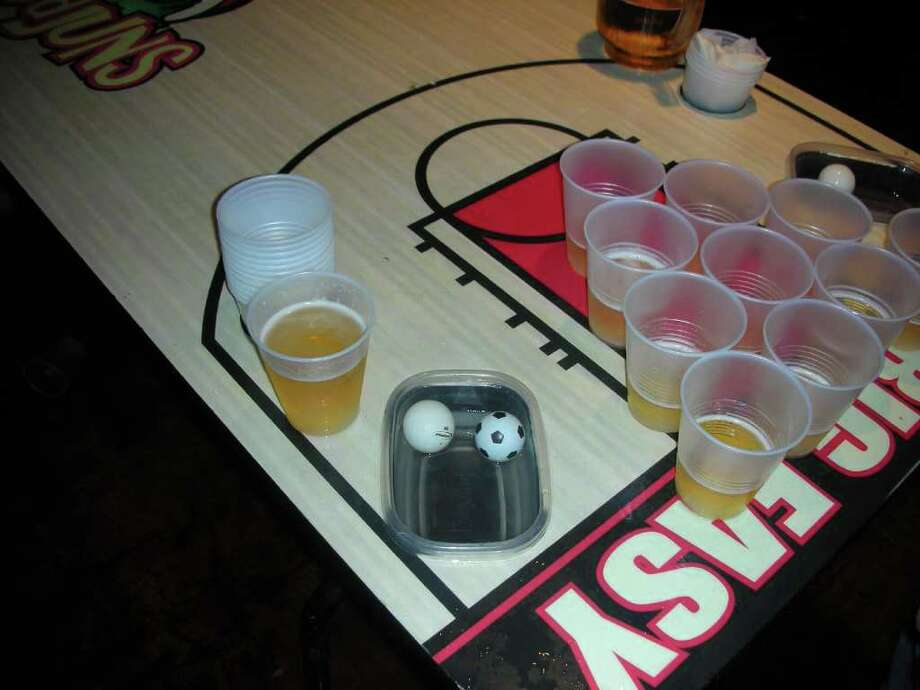 Beer Pong, showed above, is one of the top drinking games for teens and young adults. Photo courtesy of  tympsy via Flickr Photo: Contributed Photo