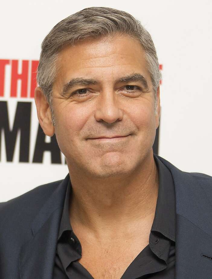 "FILE - In this Oct. 19, 2011 file photo, actor and director of the film, George Clooney poses for photographs at the official BFI London Film Festival screening of ""The Ides of March,""  in London. Clooney was nominated Thursday, Dec. 15, 2011 for best actor in a drama for his role in ""The Descendants."" Clooney is also nominated for best director for ""The Ides of March."" The Golden Globes will be presented Jan. 15 at the Beverly Hilton Hotel, televised live by NBC and hosted by Ricky Gervais. (AP Photo/Joel Ryan, file) Photo: Joel Ryan, AP"