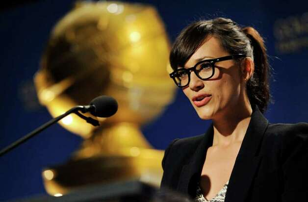 Presenter Rashida Jones announces nominations for the 69th Annual Golden Globe Awards, Thursday, Dec. 14, 2011, in Beverly Hills, Calif. The Golden Globe Awards will be held on Sunday, Jan. 15, 2012, in Beverly Hills, Calif. (AP Photo/Chris Pizzello) Photo: Chris Pizzello