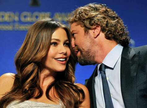 Presenter Sofia Vergara, left, and Gerard Butler mingle onstage before they announced nominations for the 69th Annual Golden Globe Awards, Thursday, Dec. 14, 2011, in Beverly Hills, Calif. The Golden Globe Awards will be held on Sunday, Jan. 15, 2012, in Beverly Hills, Calif. (AP Photo/Chris Pizzello) Photo: Chris Pizzello