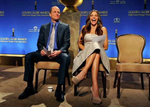 Presenters Woody Harrelson, left, and Sofia Vergara share a laugh during a break in announcing nominations for the 69th Annual Golden Globe Awards, Thursday, Dec. 14, 2011, in Beverly Hills, Calif. The Golden Globe Awards will be held on Sunday, Jan. 15, 2012, in Beverly Hills, Calif. (AP Photo/Chris Pizzello) Photo: Chris Pizzello