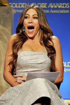 "Presenter Sofia Vergara reacts onstage after being nominated for Best Performance by an actress in supporting role in a series, mini-series or motion picture made for television for her role in ""Modern Family,"" during nominations for the 69th Annual Golden Globe Awards, Thursday, Dec. 14, 2011, in Beverly Hills, Calif. The Golden Globe Awards will be held on Sunday, Jan. 15, 2012, in Beverly Hills, Calif. (AP Photo/Chris Pizzello) Photo: Chris Pizzello"