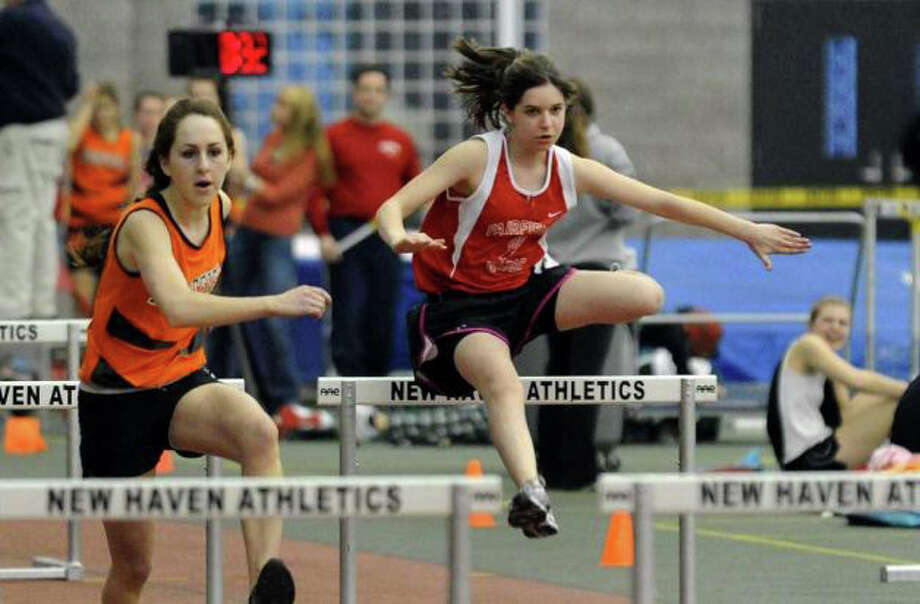 Fairfield Warde's Zoe Robbin, pictured competing at the 2011 FCIAC indoor track competitiion in New Haven, will be one of the Mustangs' top hurdlers in 2012. Photo: File Photo