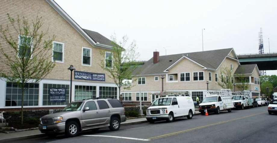 "Hamilton Development, the development arm of Gault Inc., recently received two HOBI Awards from the Home Builders Association of Connecticut Inc. for the Sauguatuck Center's ""Marsh"" and ""Tide"" buildings on Riverside Avenue, pictured above. The edifices, which contain a kayaking store, a butcher shop, financial services firms' offices and residential units, constitute the center's first phase of development, completed in May 2011. Photo: Paul Schott / Westport News"