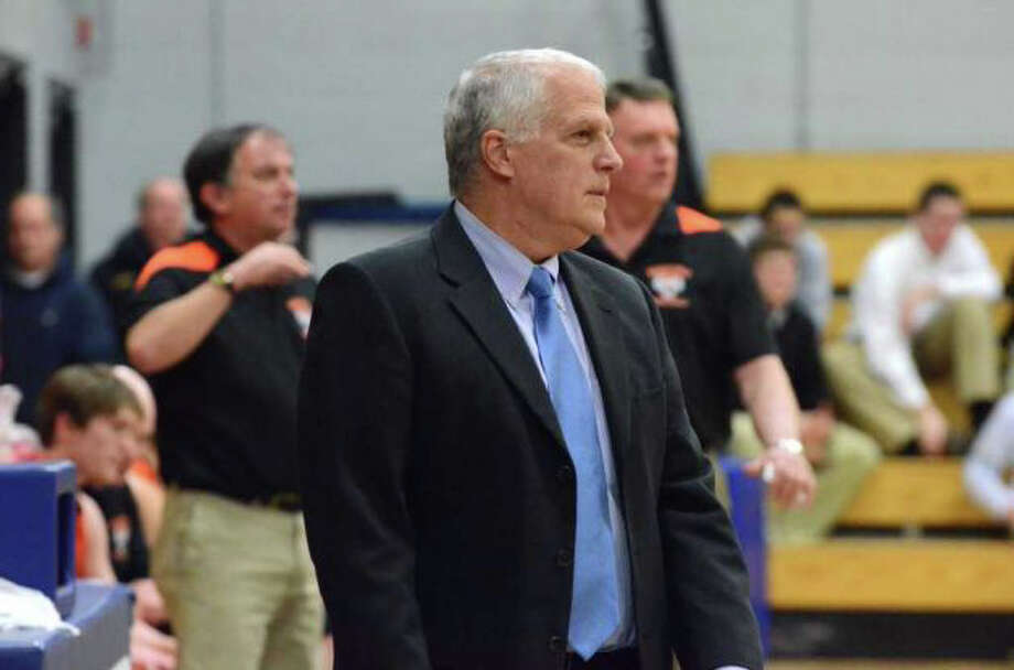Fairfield Ludlowe coach Brian Silvestro is seen coaching against Ridgefield a year ago. The second-year coach provides his club with a poised, but intense atmosphere that makes the Falcons successful. Photo: File Photo