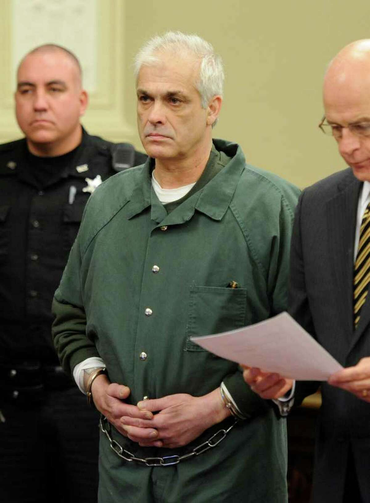 Rory Poulin, center is arraigned on murder charges at the Rensselaer County Courthouse in Troy, N.Y. Dec. 15, 2011. (Skip Dickstein / Times Union)