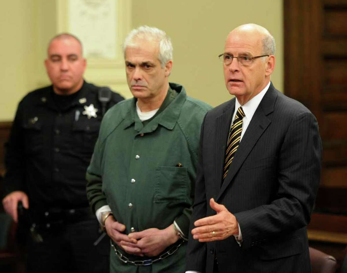 Rory Poulin, center represented by attorney Stephen R. Coffey, right, is arraigned on murder charges at the Rensselaer County Courthouse in Troy, N.Y. Dec. 15, 2011. (Skip Dickstein / Times Union)