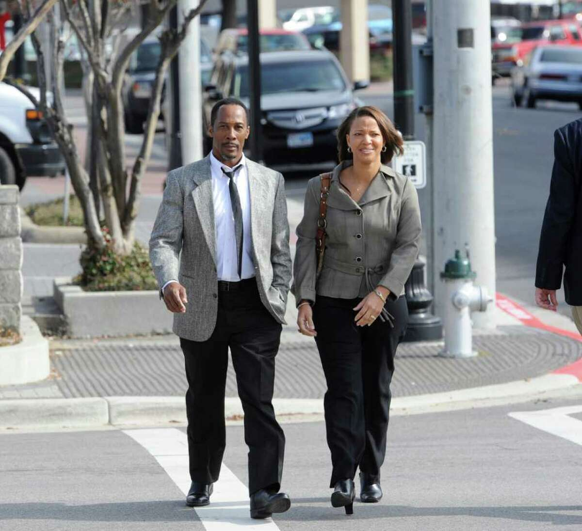 Calvin Walker, left, the Beaumont school district's electrician of record, and his wife Stacey, right, come back from lunch Monday afternoon December 12, heading to the main entrance of the Federal Courthouse. Walker is charged with fraud and overbilling the Beaumont Independent School District. Dave Ryan/The Enterprise