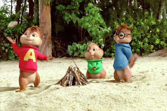 Twentieth Century Fox Stranded on a remote island, Alvin (left), Theodore and Simon try and make a fire.