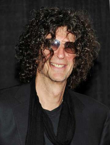 "FILE - In a Dec. 1, 2010 file photo, Howard Stern attends the Quentin Tarantino Friars Club Roast at the New York Hilton Hotel in New York. Stern will be joining the judges' panel on ""America's Got Talent,"" and the NBC summer talent show will uproot itself from Los Angeles to accommodate the New York-based shock jock, the network said Thursday. Stern, whose daily radio show airs on Sirius XM, is replacing Piers Morgan, who departed ""Talent"" after last season to free up his busy schedule.  (AP Photo/Evan Agostini) Photo: Evan Agostini, ASSOCIATED PRESS / AP2010"