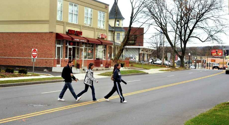 Students cross White Street in Danbury at a popular crossing spot in front of Western Connecticut State University recently. The nearest crosswalks are on either ends of the block. Photo: Michael Duffy
