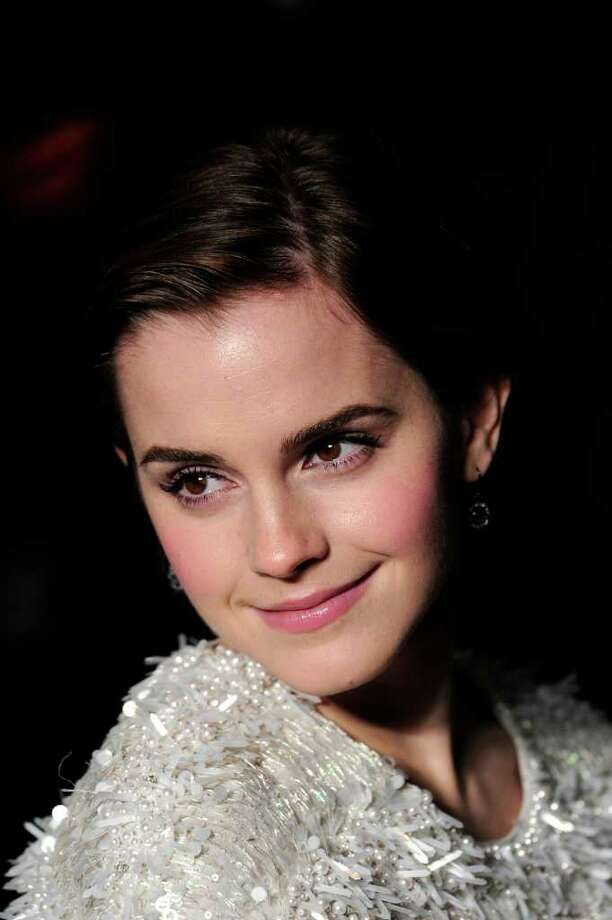 """STAR SHINE: Emma Watson paired shimmery eye shadow with a sweet pink lipstick and blush -- and a shiny top -- for the British premiere of  """"My Week with Marilyn."""" Photo: CARL COURT / AFP"""