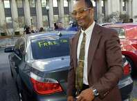 After helping his wife into their car, Calvin Walker smiles as he walks past a message on his rear windshield, and the media who had surrounded him and his wife, after leaving the Federal Courthouse Thursday afternoon.  U.S. District Judge Ron Clark declared a mistrial in the Calvin Walker federal trial. The 12 person federal jury was deadlocked on reaching a verdict in the case.  Walker, 51, right, the Beaumont Independent School District's electrician of record, was accused of defrauding and overbilling the district by nearly $4 million. He was indicted on 37 federal counts in May. Dave Ryan/The Enterprise