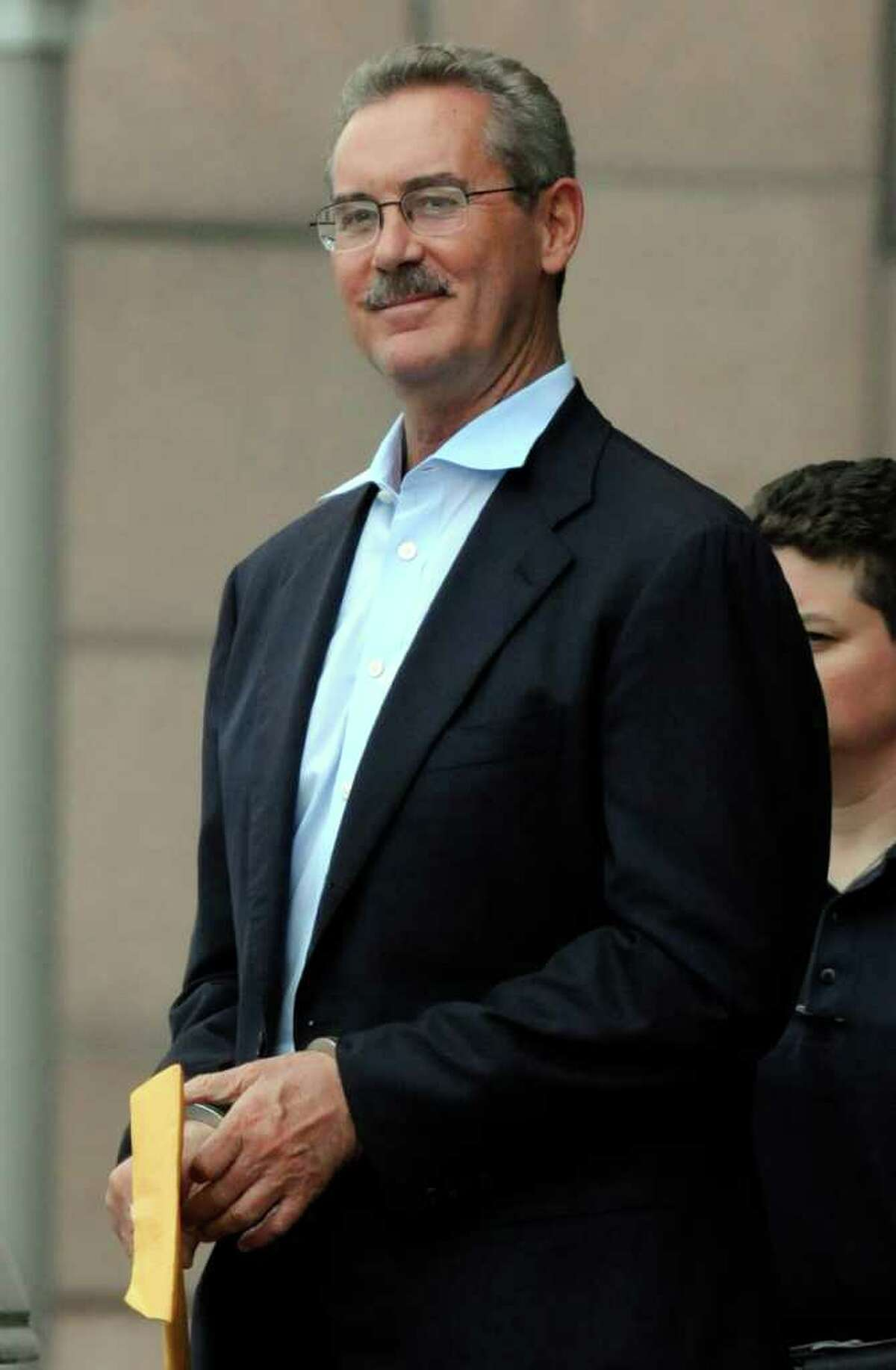 FILE - In this June 29, 2009 file photo, billionaire R. Allen Stanford smiles as he is escorted out of the federal courthouse in Houston. Federal prosecutors say Thursday, Dec. 15, 2011 that jailed Texas financier Stanford, who was declared incompetent to stand trial earlier this year, is now competent to be tried next month. Stanford is accused of bilking investors out of $7 billion in a massive Ponzi scheme.