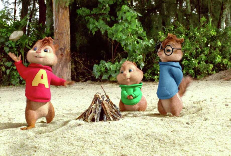 20TH CENTURY FOX HIT THE BEACH: Alvin, from left, Theodore and Simon are shipwrecked on a deserted island. Photo: Courtesy Twentieth Century Fox / Alvin and The Chipmunks, The Chipettes and Characters TM and © 2011 Bagdasarian Productions, LLC. All rights reserved. © 2011 Tw
