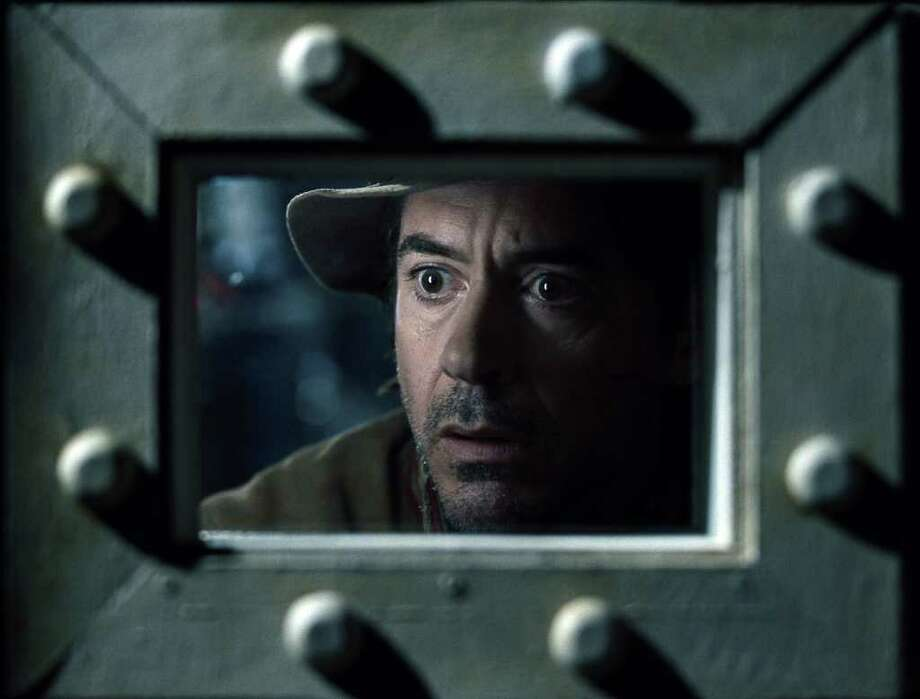 WARNER BROS. PICTURES LACK OF EFFORT: Robert Downey Jr. might deserve to be locked up for his uninspired performance in Sherlock Holmes: A Game of Shadows. Photo: Courtesy Of Warner Bros. / © 2011 Warner Bros. Entertainment Inc. - - U.S., Canada, Bahamas & Bermuda © 2011 Village Roadshow Films (BVI) Limited - - All o