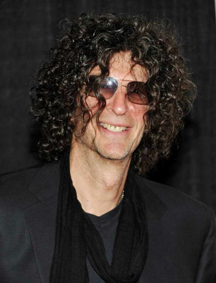"""FILE - In a Dec. 1, 2010 file photo, Howard Stern attends the Quentin Tarantino Friars Club Roast at the New York Hilton Hotel in New York. Stern will be joining the judges' panel on """"America's Got Talent,"""" and the NBC summer talent show will uproot itself from Los Angeles to accommodate the New York-based shock jock, the network said Thursday. Stern, whose daily radio show airs on Sirius XM, is replacing Piers Morgan, who departed """"Talent"""" after last season to free up his busy schedule.  (AP Photo/Evan Agostini) Photo: Evan Agostini / AP2010"""