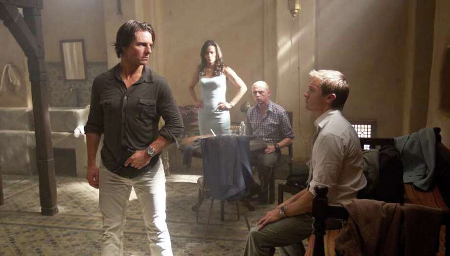 PARAMOUNT PICTURES NEW FACES: Tom Cruise, from left, reprising his role as Ethan Hunt, is joined by Paula Patton, Simon Pegg and Jeremy Renner in Mission: Impossible - Ghost Protocol. Photo: David James / © 2011 Paramount Pictures.  All Rights Reserved.