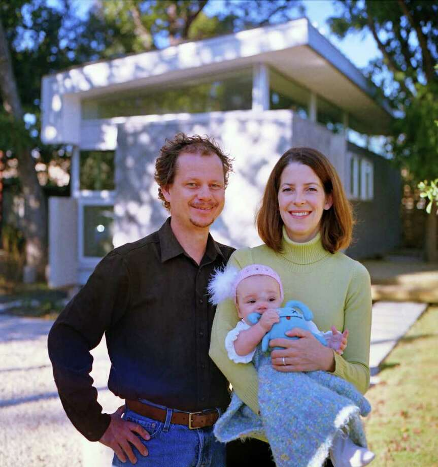 Mark Schatz and Anne Eamon, who now have a daughter, Wren, have been experimenting with ways to live well on a small scale for about 14 years. Photo: TODD SPOTH / Todd Spoth