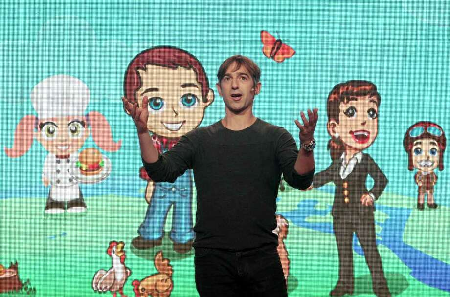 JEFF CHIU : ASSOCIATED PRESS FILE FARMVILLE'S CREATOR: CEO Mark Pincus, shown at a Zynga event in San Francisco, named his company after his dog. Zynga is the online game maker behind FarmVille. Photo: Jeff Chiu / AP2011