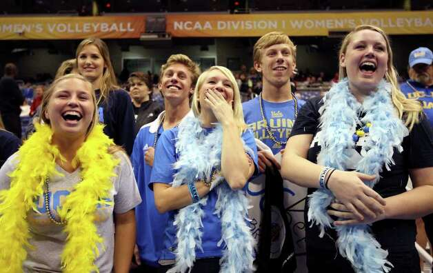 FOR SPORTS - UCLA fans Lisa Gera (from left) Connor Reeves, Katie Glomb, Jake Reeves, and Lacey Gera watch the team warm up before the game with Florida State during the 2011 NCAA Division I Women's Volleyball National Semifinal Championship match Thursday Dec. 15, 2011 at the Alamodome. Lisa and Lacey are the sisters of UCLA's Lainey Gera. Connor and Jake are the brothers of UCLA's Kelly Reeves.  PHOTO BY EDWARD A. ORNELAS/eaornelas@express-news.net) Photo: EDWARD A. ORNELAS, SAN ANTONIO EXPRESS-NEWS / © SAN ANTONIO EXPRESS-NEWS (NFS)